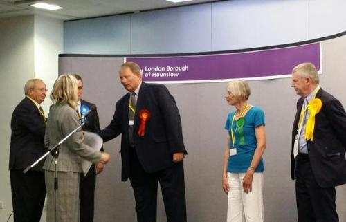 Councillor for Brentford Ward Guy Lambert being congratulated on his win by other candidates and Chief Executive of Hounslow Council